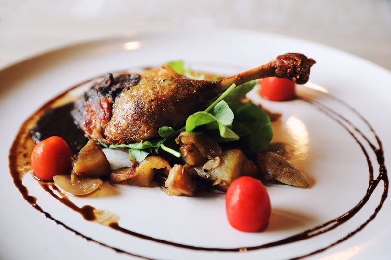 French Food Duck Confit Roasted Duck Temptation Dinner Garnish Indulgence Meal Selective Focus Table Wellbeing Meat No People Still Life Fruit Tomato Healthy Eating Close-up Serving Size Vegetable Ready-to-eat Plate Freshness Food And Drink Food