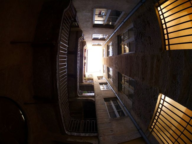 Apartment Architecture Building Built Structure Day Directly Below Indoors  Nature No People Railing Residential District Spiral Spiral Staircase Staircase Steps And Staircases Sunlight Wall Wall - Building Feature Window