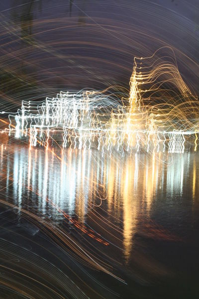 Abstract Light line generated by moving the camera Moving Night Lights Abstract Beauty In Nature Blurred Motion City Night Close-up Illuminated Lake Light And Shadow Light Lines Nature Night Night View Outdoors Reflection Scenics Shake Water Waterfront