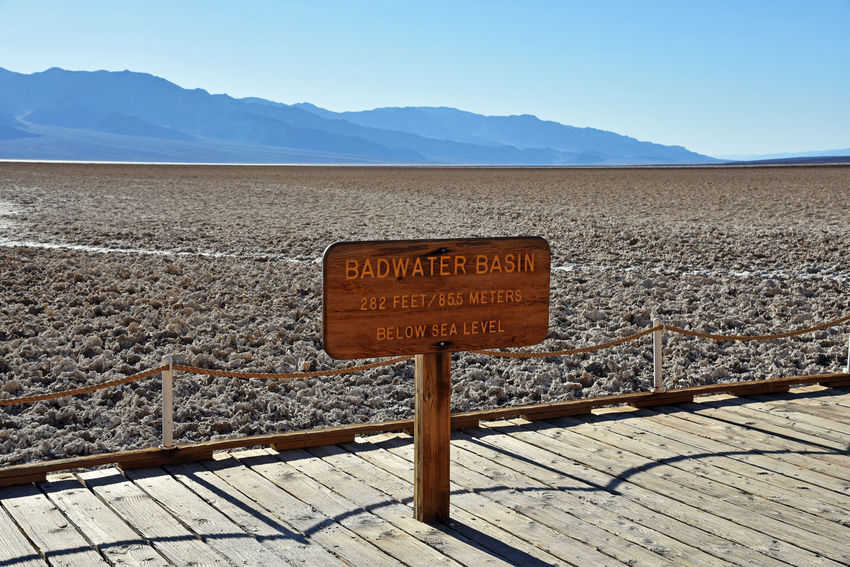 Badwater Basin in Death Valley National Park, California. 282 feet/85.5 meters below sea level. This series of pictures at DV was taken in May 2017. Badwater Basin California Death Valley Desert Hot Sunny Board Dry Heat Mountain Range