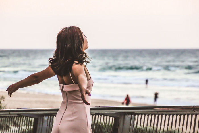 Adult Beach Beauty In Nature Clear Sky Day Focus On Foreground Gratitude Horizon Over Water Leisure Activity Lifestyles Nature One Person Outdoors People Railing Real People Rear View Scenics Sea Sky Standing Water Women Young Adult Young Women