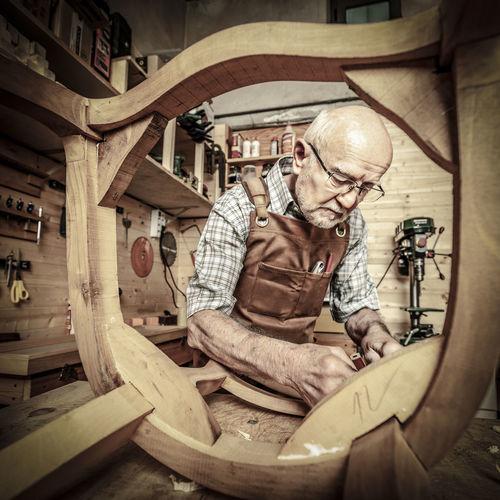 Apron Man At Work Woodworker Adult Aged Beard Bearded Carpenter Carpenter Tools Craftsmanship  Indoors  Labor Occupation Portrait Senior Senior Adult Traditional Job Woodworking Working Workshop