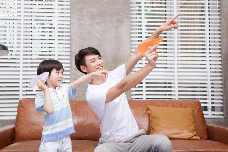 EyeEm Selects Family Happiness Lifestyles Togetherness Men Living Room Domestic Life Human Arm Indoors  Enjoyment Family With One Child Adult Sofa Joy Human Body Part Home Interior Father Casual Clothing Smiling Cheerful