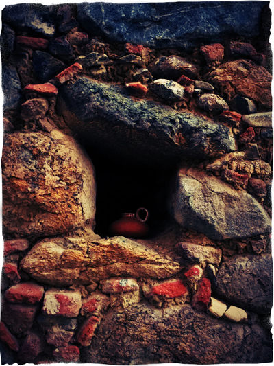small jug of clay inside a hole of a stone wall - 1 Arch Auto Post Production Filter Brown Eyes Cave Clay Jug History Hole In The Wall Inside A Water Bottle Multi Colored No People Old Red Rock Formation Rugged Stone Stone Wall Tranquility Weathered Weathered