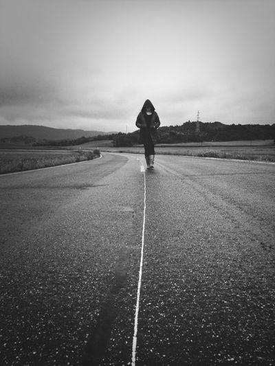 Full length of woman walking on road