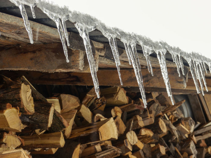Icicles Close-up Cold Temperature Day Icicle Low Angle View Nature No People Outdoors Snow Stack Winter Wood - Material