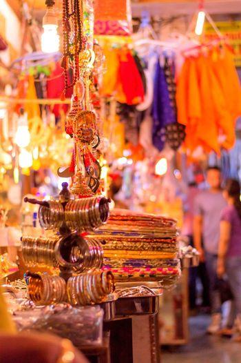Bangles hanging at illuminated market
