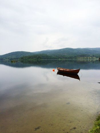 Transportation Nautical Vessel Boat Mode Of Transport Water Mountain Sky Tranquil Scene Tranquility Scenics Reflection Cloud Nature Calm Travel Destinations Mountain Range Beauty In Nature Non-urban Scene Tourism Cloud - Sky