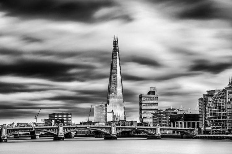 Thames River By Shard Against Sky