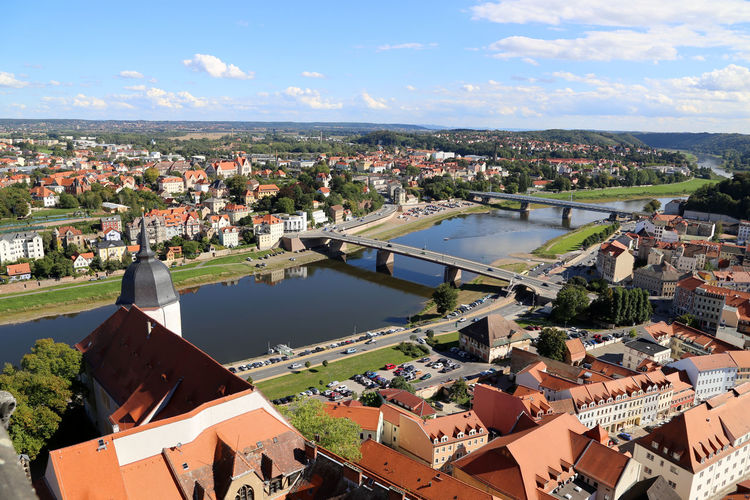High angle view of bridge over elbe river against sky in town