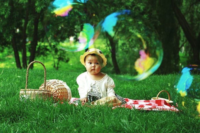 Children Only Child Childhood Grass One Person People Full Length One Girl Only Discovery Blond Hair Outdoors Playing Happiness Sitting Day Nature Smiling