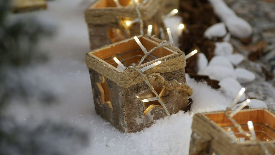 Flame Candle Burning Fire Celebration Christmas Holiday Moments Snow Close-up Winter Indoors  Decoration Holiday Cold Temperature Illuminated Christmas Decoration Focus On Foreground High Angle View