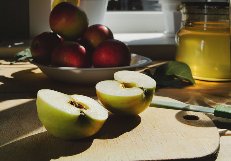Close-up of apples on table at home