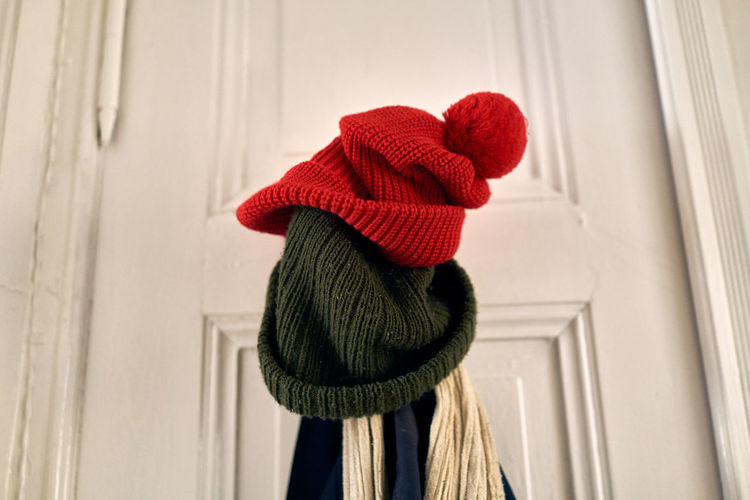 Close-up of hat against window
