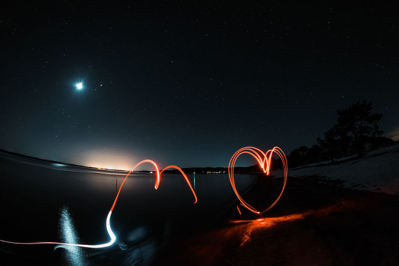 Light Paintings At Beach Against During Night
