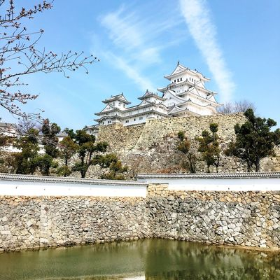 Architecture Belief Building Building Exterior Built Structure Cloud - Sky Day Himeji Castle Lake Nature No People Outdoors Place Of Worship Plant Religion Sky Spire  Spirituality The Past Travel Destinations Tree Water