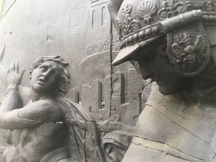 Low angle view of statue against wall