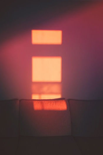 Illuminated Indoors  No People Lighting Equipment Wall - Building Feature Glowing Light - Natural Phenomenon Light Red Architecture Electric Light Domestic Room Orange Color Night Seat Electricity  Modern Wall Absence Shadow Electric Lamp Ceiling Sunset Sunlight Hand Shape Abstract Window Bin Red Sofa Wall Inside