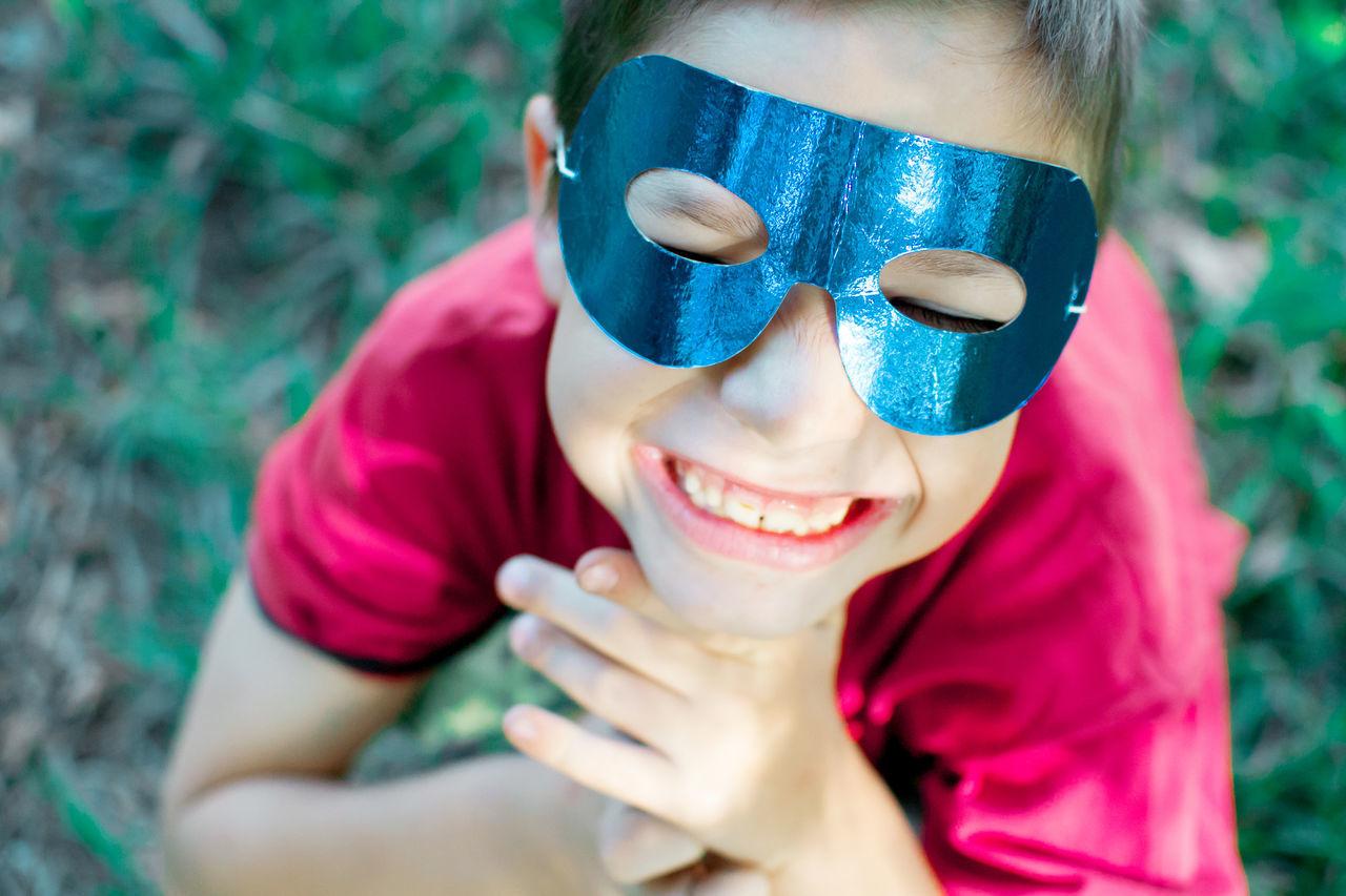 Close-up of smiling boy wearing mask