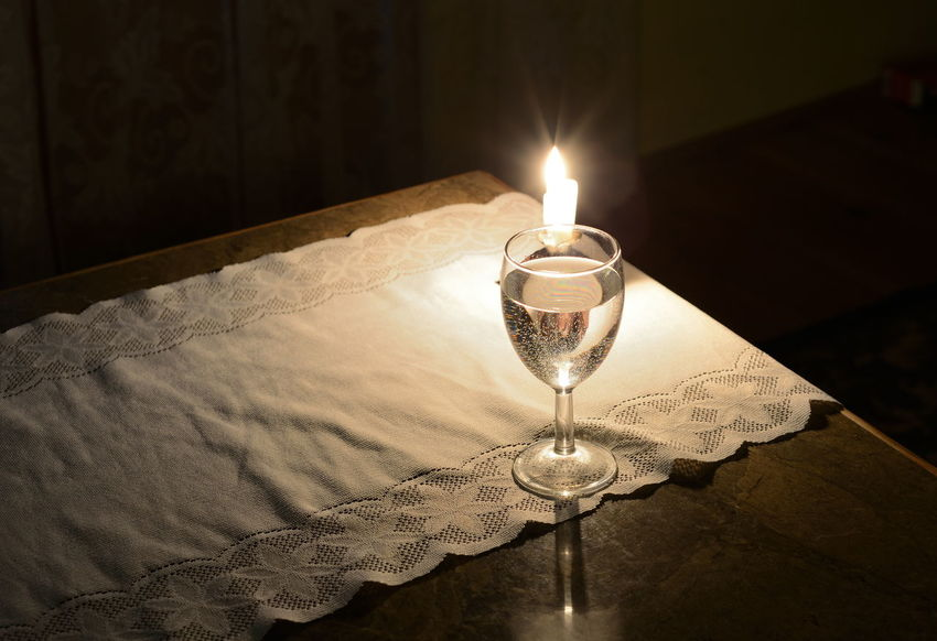 Still-Life with Candle and Glass Bubbles Burning Candle Candlestick Close-up Flame Glass Illuminated Indoors  Lighting Equipment No People Poland Polska Table Table Cloth Water
