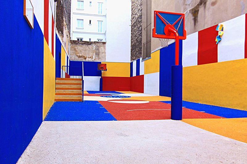Multi colored flag in city