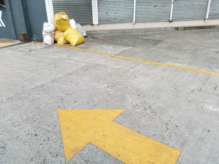 Yellow working on footpath