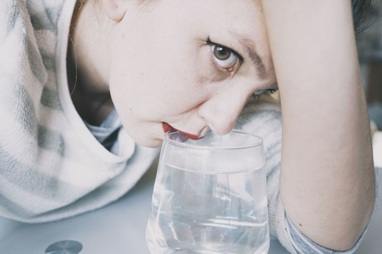 Close-up portrait of a drinking water
