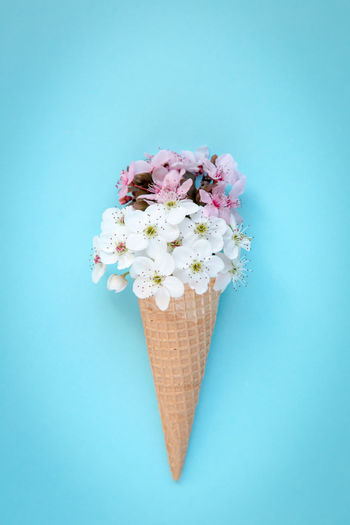 Close-up of ice cream against blue background