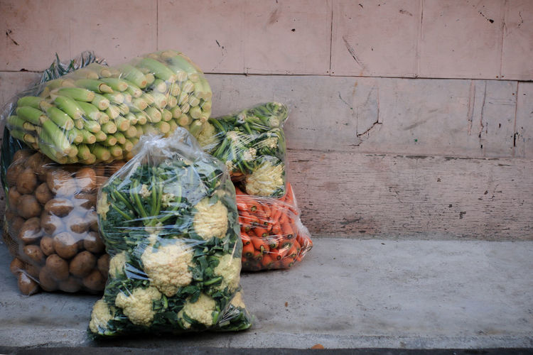 Abundance Choice Container Day Food Food And Drink Freshness Fruit Green Color Healthy Eating Large Group Of Objects No People Outdoors Plastic Bag Raw Food Retail  Still Life Variation Vegetable Wall - Building Feature Wellbeing