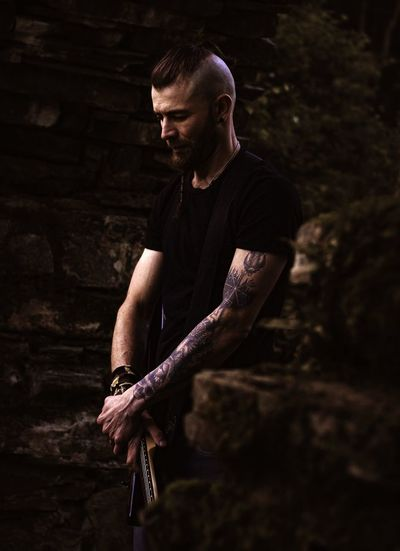 Man with tattoo standing outdoors