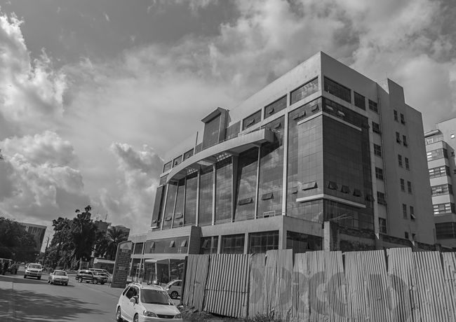 a building in Kampala Uganda  Africa Architecture Building Exterior Built Structure Car City Cloud - Sky Day Kampala Land Vehicle Mode Of Transport Monochrome Nature No People Outdoors Road Sky Transportation Tree