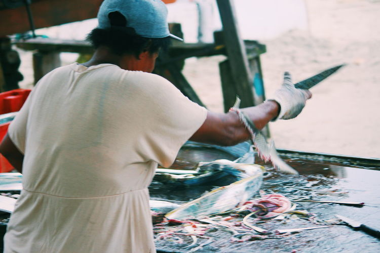 Rear View Of Woman Selling Fish