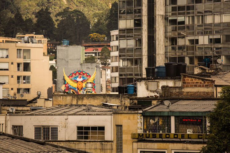 Bogotá Colombia Bogotá Casual South America Latin America Architecture Building Exterior Built Structure Building City Residential District Day No People Flag Outdoors Nature Window Plant Tree Roof Multi Colored High Angle View Graffiti House Apartment
