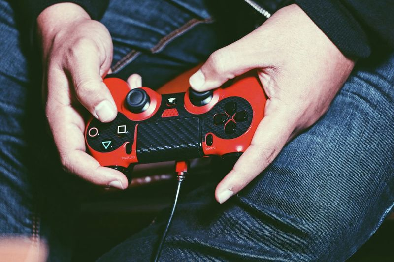 Joystick FreeTime Red Relaxing Jeans Handsome Hand Playing Games Game Joystick Real People Midsection Human Hand One Person Hand Human Body Part Musical Instrument Indoors  Holding Lifestyles Leisure Activity String Instrument Close-up Arts Culture And Entertainment Skill  Finger Playing
