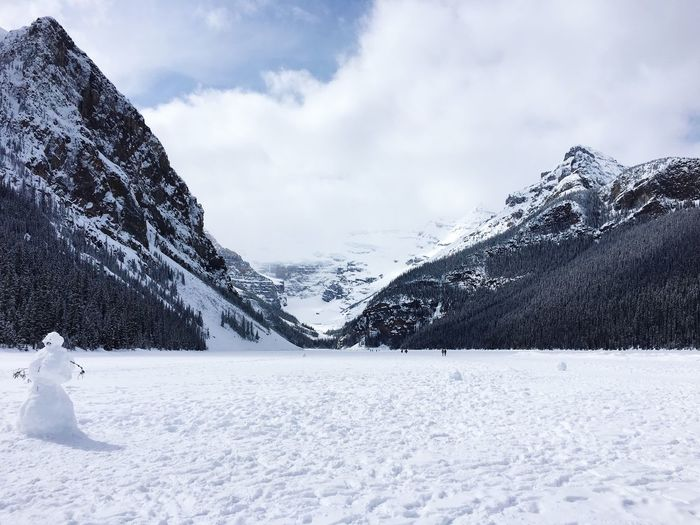 Frozen Lake Louise Snow Winter Cold Temperature Weather Nature Beauty In Nature Mountain Scenics Frozen White Color Tranquility Outdoors Sky Snowcapped Mountain Cloud - Sky Day No People One Animal Landscape Lake Louise,Alberta