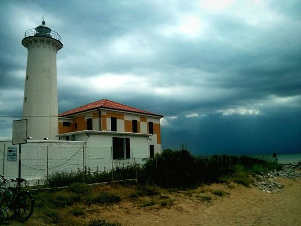 The storm is coming! Cloud - Sky Sky Building Exterior Architecture Dramatic Sky Built Structure Outdoors No People Storm Cloud Nature Storm Stormy Weather Storm Clouds Light And Shadow Lighthouse Bibione Lost In The Landscape