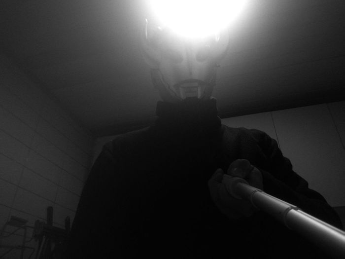 Low angle view of person holding illuminated lamp