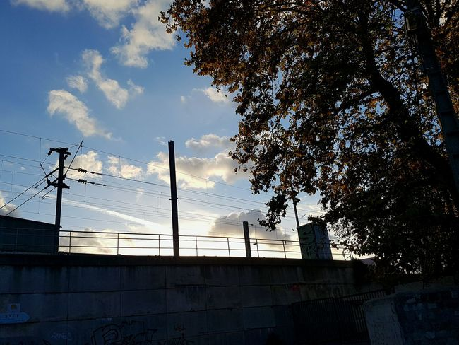 Sunset Sky No People Silhouette Low Angle View Tree Nature Day Outdoors Train Morning View Nofilter European  Galaxy S7 Taking Photos Clouds City Train Station Train