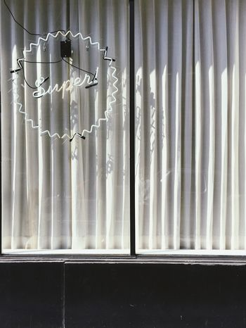 White Neon sign in a window with curtains during the daytime Curtain Building Exterior Building Signage Sign White Neon Sign Window Indoors  Curtain No People Security Glass - Material Safety Day Wall - Building Feature Blinds