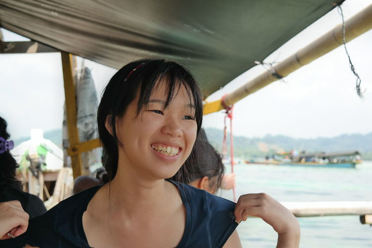 Smiling Woman Sitting In Ferry Boat