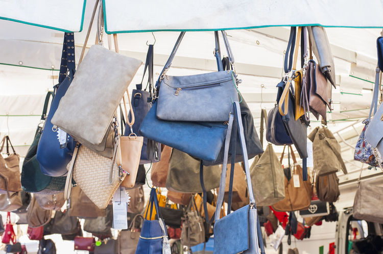 Women's handbags for sale at an outdoor market Accessory Bags Choice Clothing Coathanger Day Fashion Freedom Handbags Hanging Large Group Of Objects Market Stall No People Outdoors Retail  Variation