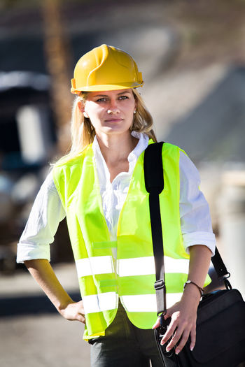 Architect wearing reflective clothing standing outdoors