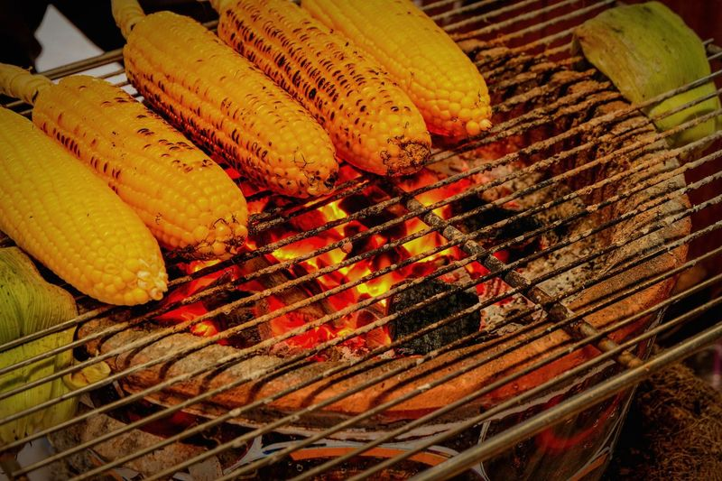 Yellow corn grilled Snack Appetizer Party Vetgetable Vegetarian Food BBQ Nutrition Food Traditional Furnace Retro Furnace Charcoal Fire Charcoal Red Charcoal Roasted Corn Corn Grill Popcorns Yellow Corn Barbecue Grill Food Barbecue Freshness Grilled No People Heat - Temperature Preparation  Healthy Eating Close-up Outdoors
