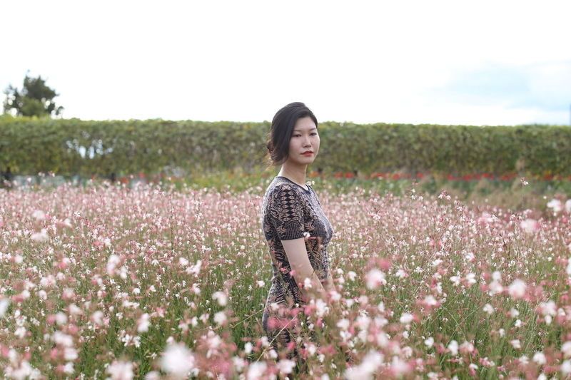 Beautiful Woman Beauty Beauty In Nature Day Field Flower Fragility Freshness Nature One Woman Only Outdoors Plant Real People Rural Scene Selective Focus Standing Tranquility Women Young Adult Young Women