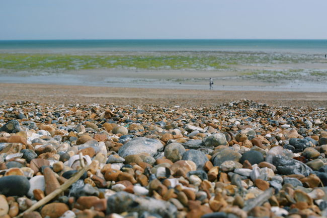 Beach Beauty In Nature Day Horizon Horizon Over Water Land Nature No People Outdoors Pebble Rock Scenics - Nature Sea Sky Solid Stone Stone - Object Surface Level Tranquil Scene Tranquility Water