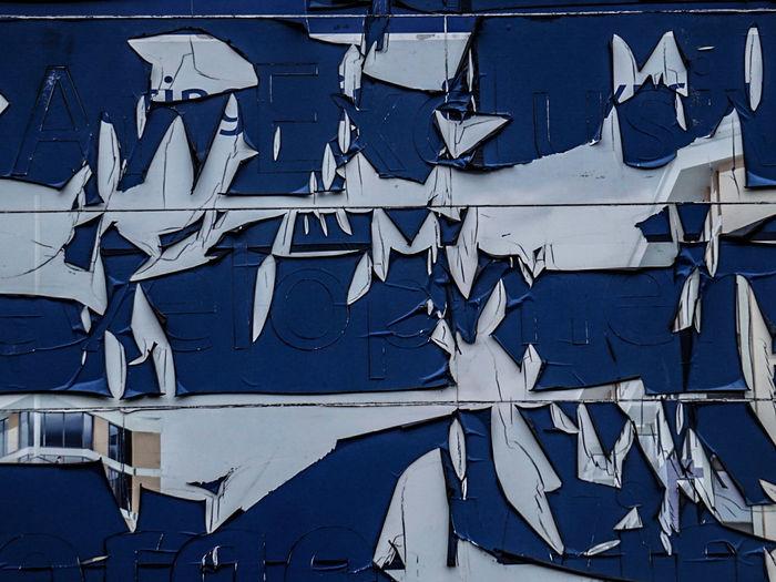 Paint peeling from billboard