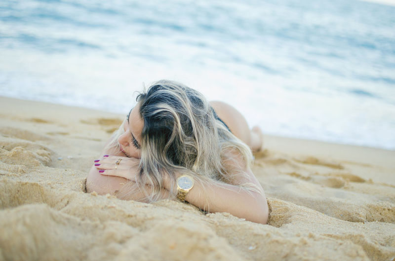 Beach Sand Land Lying Down One Person Relaxation Sea Leisure Activity Hair Holiday Women Nature Vacations Trip Lying On Front Lifestyles Day Hairstyle Outdoors Beautiful Woman Surface Level