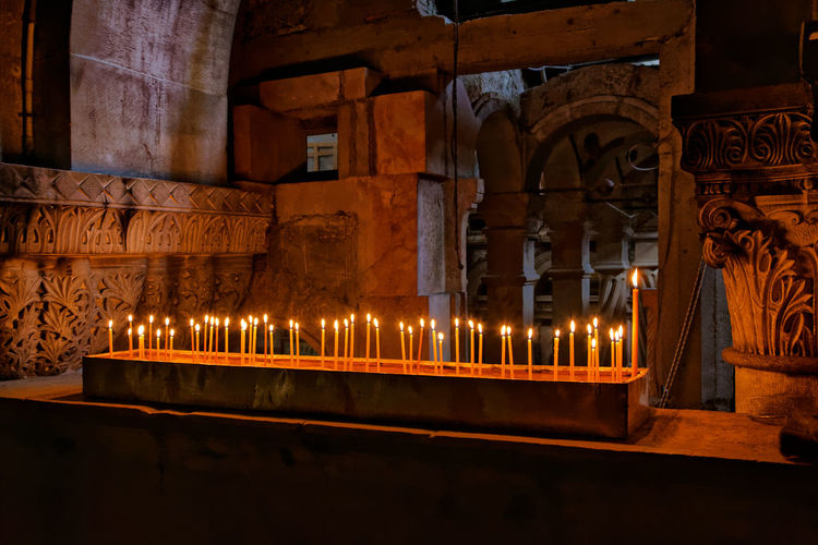 Illuminated candles in church of the holy sepulchre