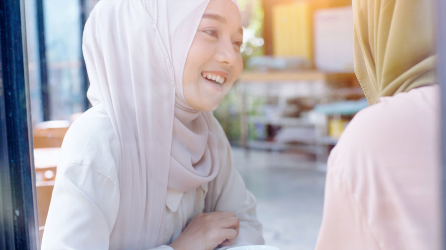 Beautiful young women in hijab at cafe