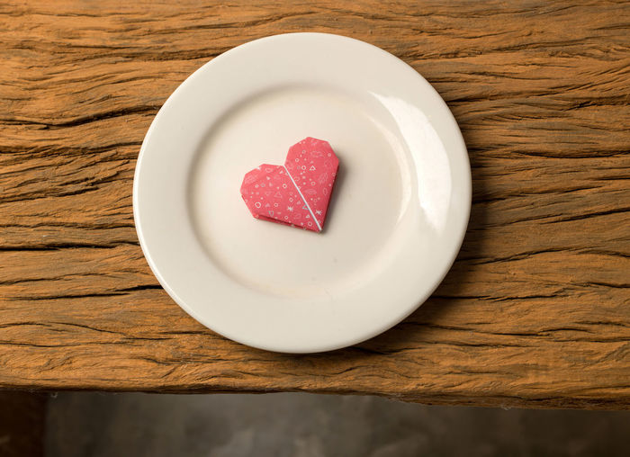 Directly above shot of heart shape in plate on table